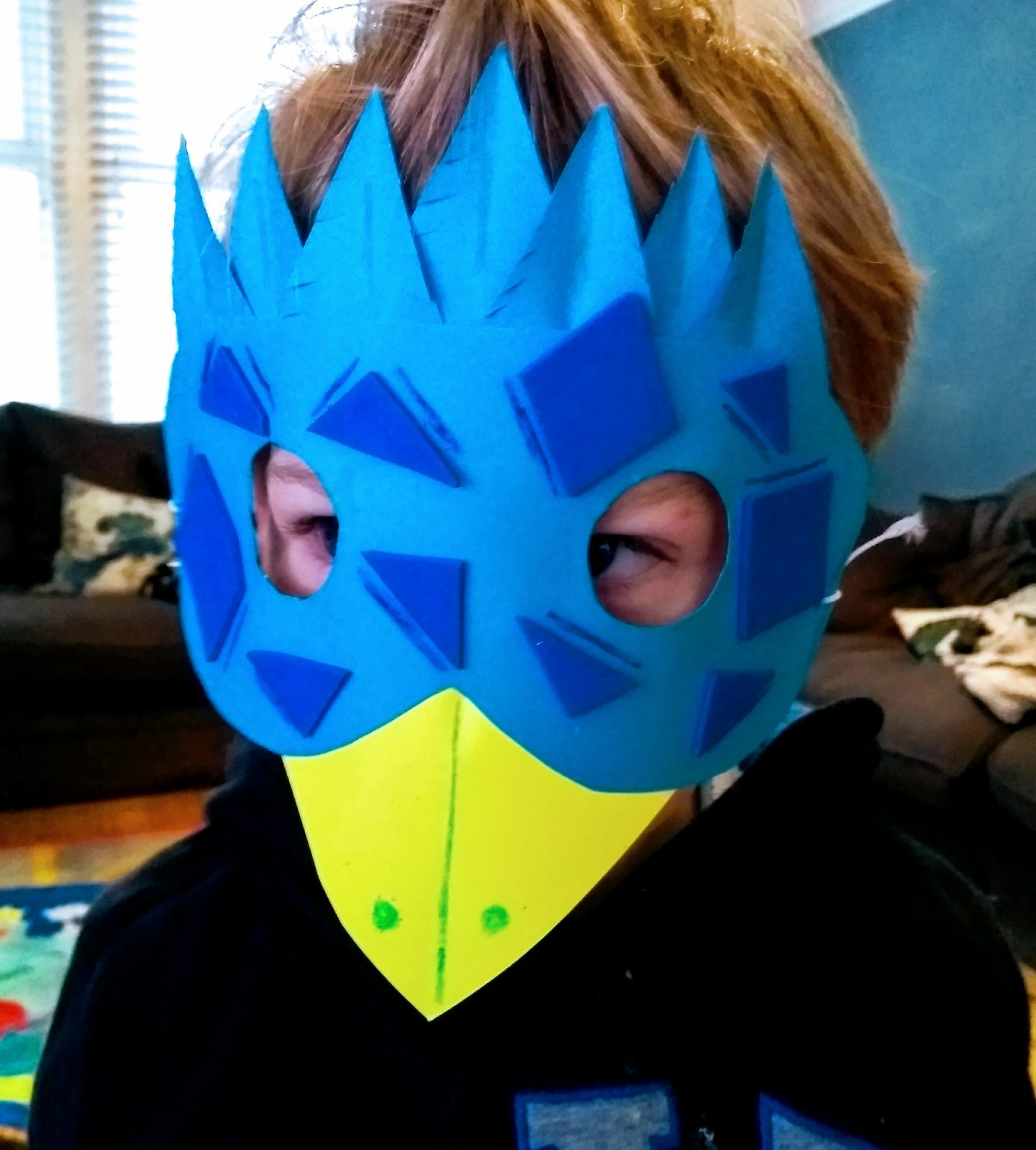 Nathan crafts a parrot mask